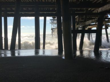waves crushing onto the pier